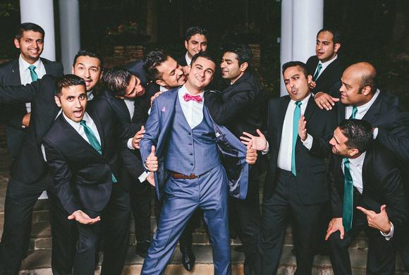 groomsmen silly pose wedding