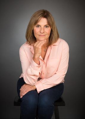 woman salmon shirt with gray background studio portrait