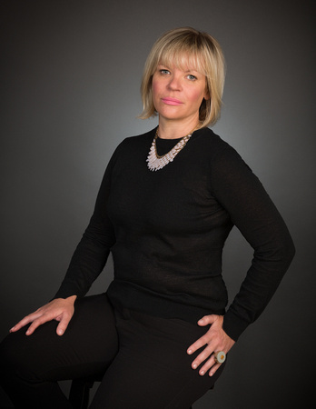 woman blond hair  with gray background studio portrait