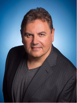 Man Headshot Executive with blue background in Studio