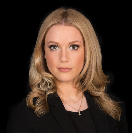 woman with blond hair against black backdrop studio