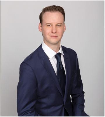 man_with_suit_portrait_studio_gray_background