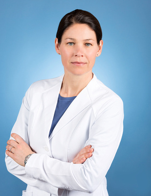 woman_in_medical_lab_coat_white_portrait