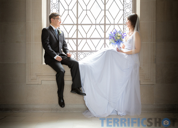 wedding_bride_and_groom_by_window_san_francisco_city_hall