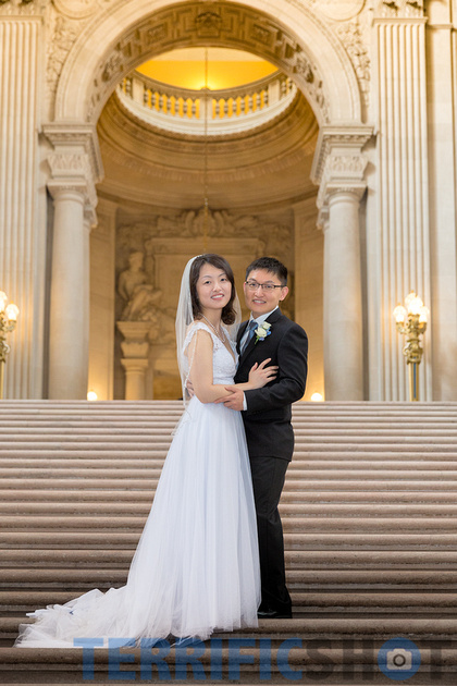 wedding_bride_and_groom_standing_stairs_by_san_francisco_city_hall_black_white