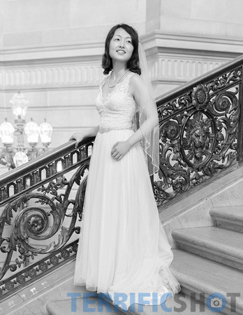 wedding_bride_posing_on_stairs_san_francisco_city_hall_black_white