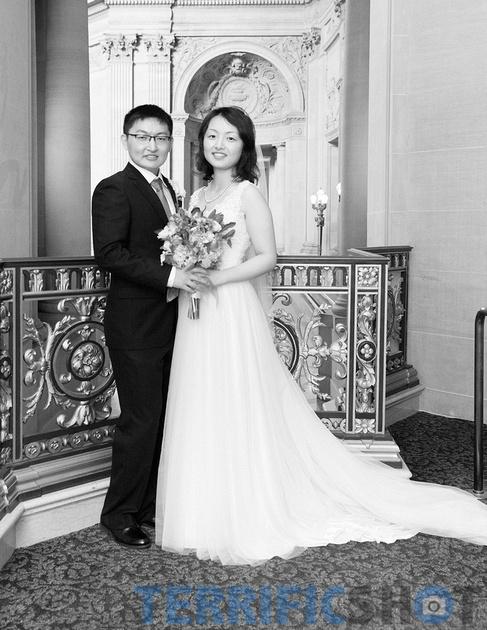 wedding_couple_posing_san_francisco_city_hall_black_white