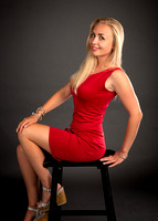 woman_seating_red_dress_glamour_studio
