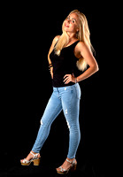 woman_standing_jeans_pants_pose_glamour_studio