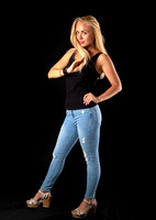 woman_with_blond_hair_standing_jeans_pants_glamour_studio